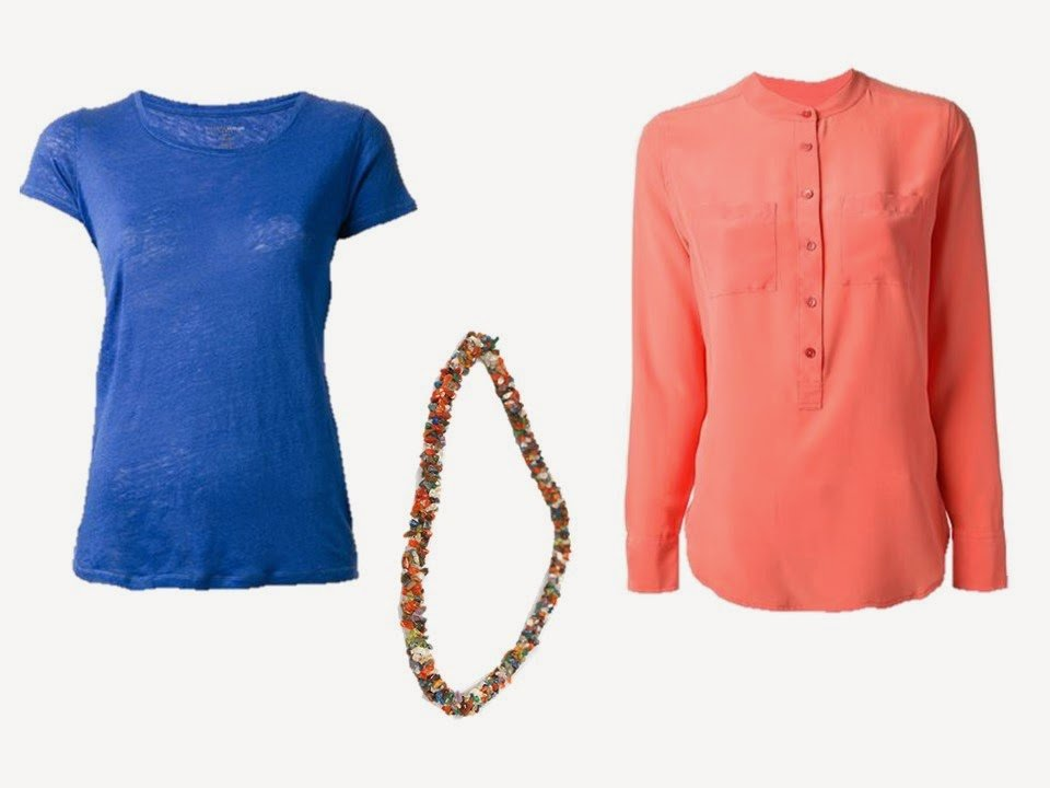 blue tee shirt, multi-gem necklace, and coral tunic