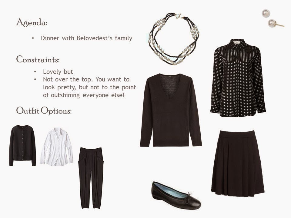 Black pleated skirt and v-neck sweater with a black and white patterned blouse, pearl jewelry, and black ballet flats