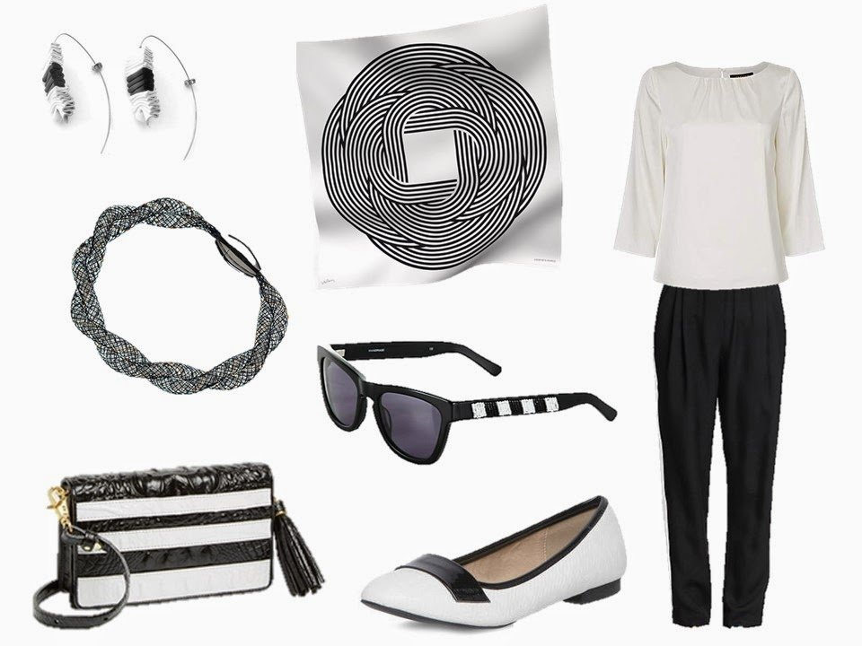 Hermes Maillons de Joel Stein with a white blouse, black pants, and related accessories