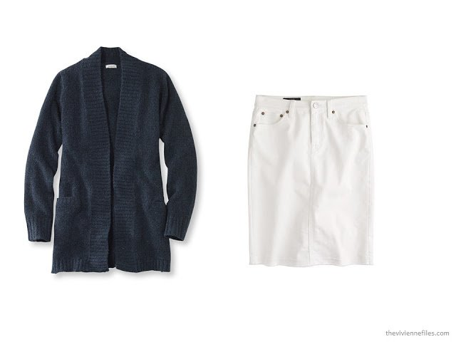A basic navy cardigan and white skirt offer many options in a capsule wardrobe
