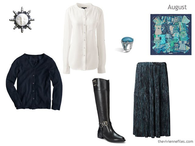 navy cardigan, cream blouse and bluegreen textured skirt