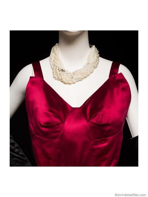 detail of Mainboucher red satin evening dress