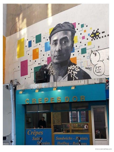 Paris street art man with bright geometric design
