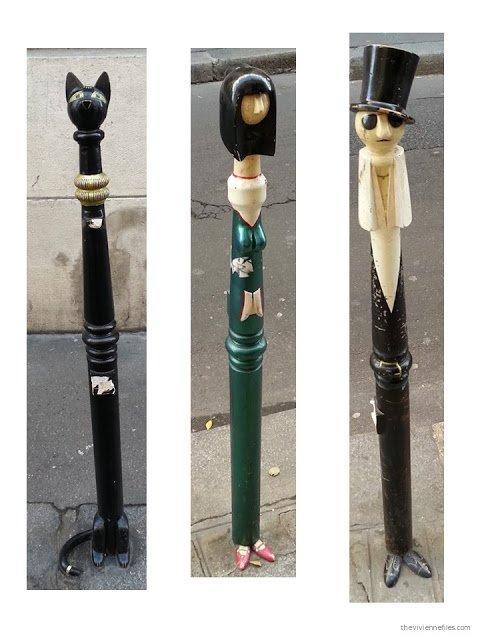 Paris street art decorated traffic control black metal poles