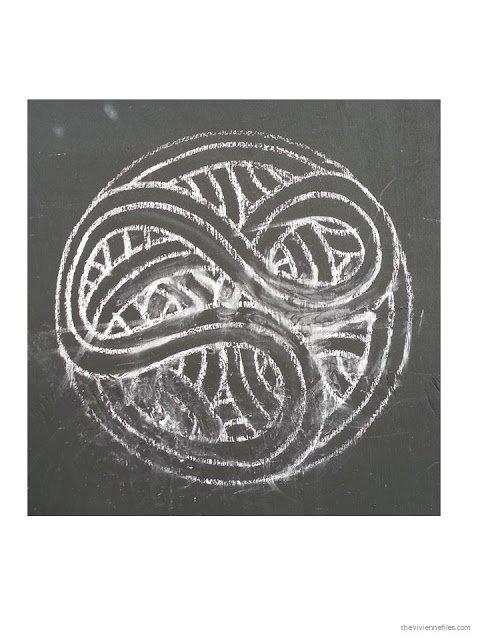 Paris street art chalk drawn Celtic motif circle