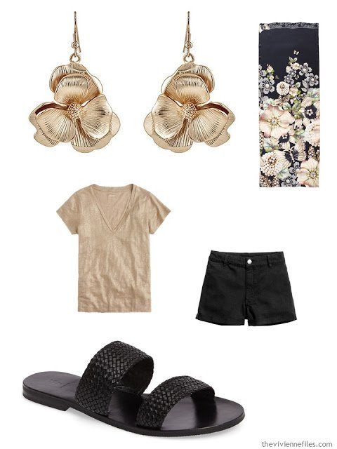 gold tee and black shorts with gold flower earrings and black flat sandals