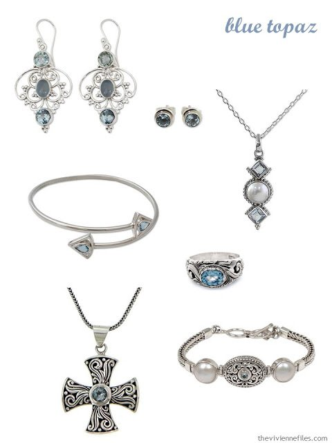 a family of seven pieces of blue topaz jewelry
