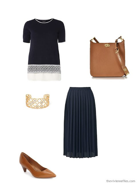 navy top and skirt with brown leather accessories
