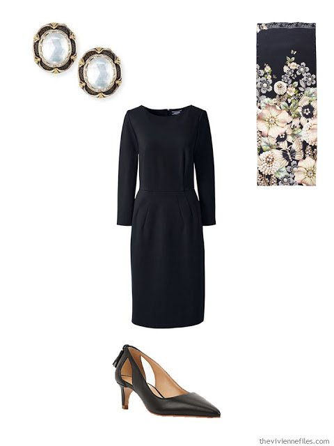 black dress with mother of pearl earrings and black pumps