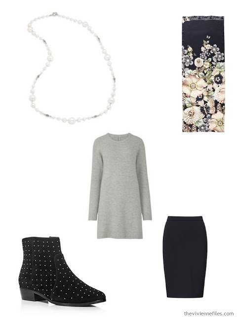 grey tunic and black skirt, with silver and pearl necklace, and studded boots