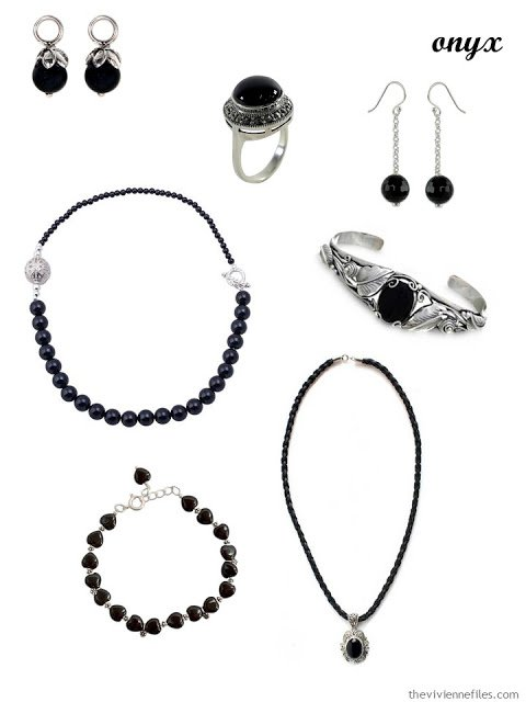 a family of seven pieces of onyx jewelry
