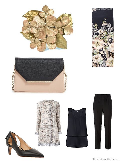 beige and black tweed jacket with black silk separates, a floral brooch, and two-toned handbag