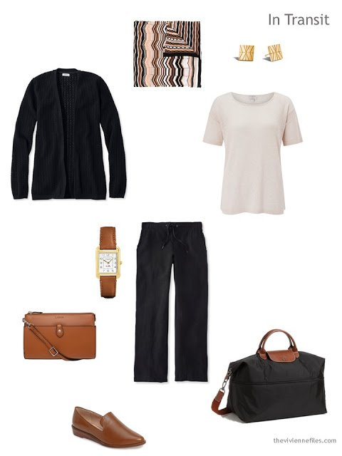 travel outfit in black and ivory with brown leather accents