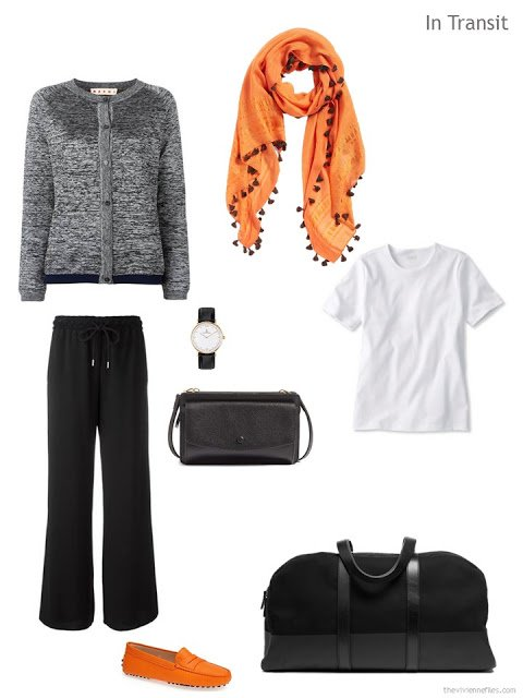 travel outfit in black and white with orange accents