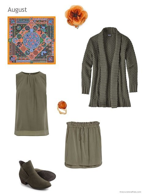 an olive skirt outfit with orange accessories