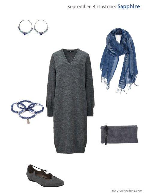 grey dress with sapphire jewelry
