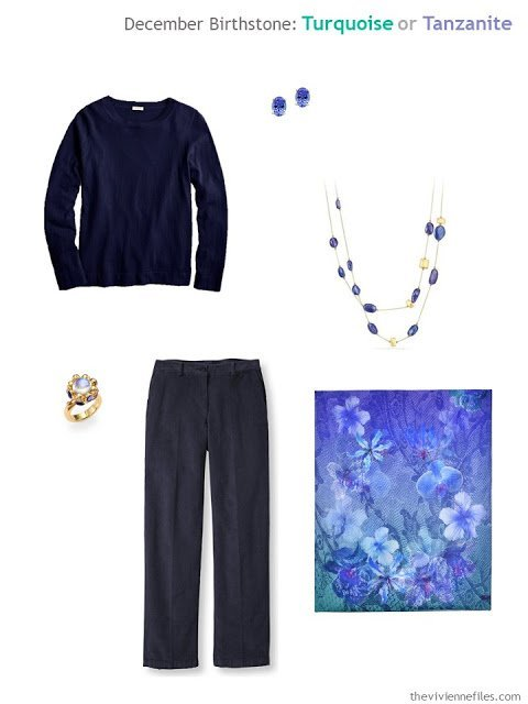 a navy outfit worn with tanzanite jewelry and a purple floral scarf