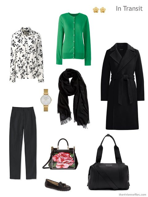 winter travel outfit in black, white and green