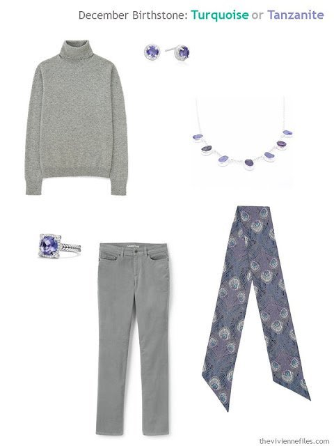 a grey outfit worn with tanzanite jewelry and a peacock print scarf