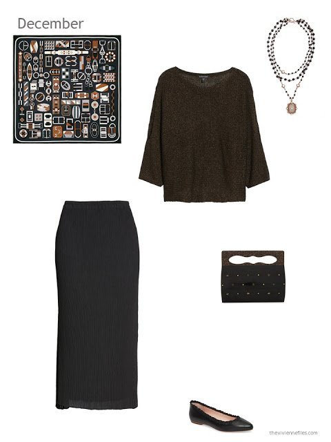 a bronze metallic sweater with a black pleated skirt
