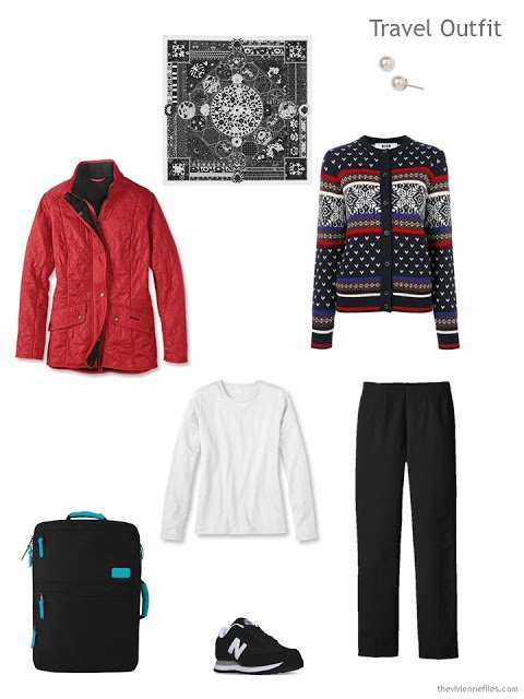 a travel outfit in black, white and red for cold weather