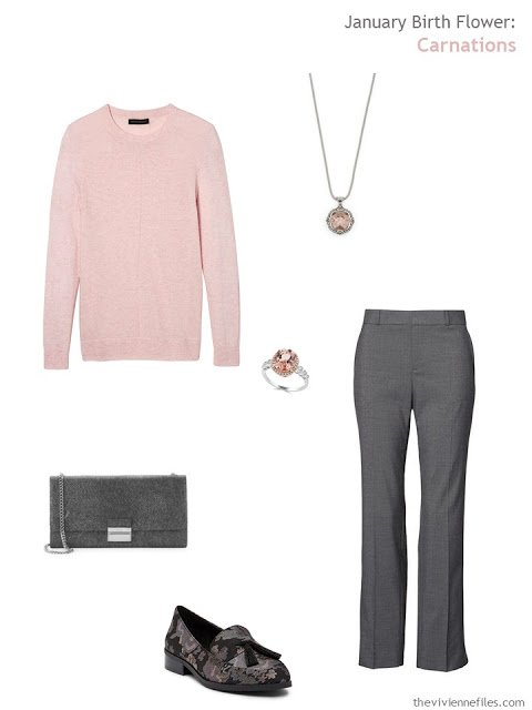 wearing a carnation pink sweater with grey
