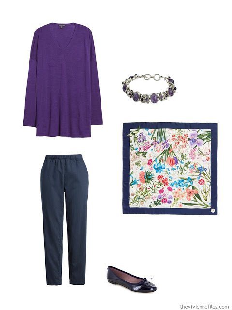 wearing an ultraviolet tunic with navy pants