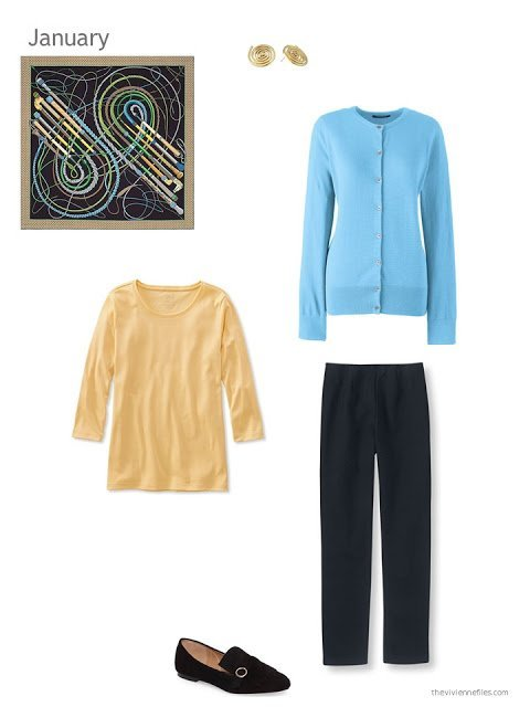 aqua blue cardigan, yellow tee shirt and black pants, united by an Hermes scarf