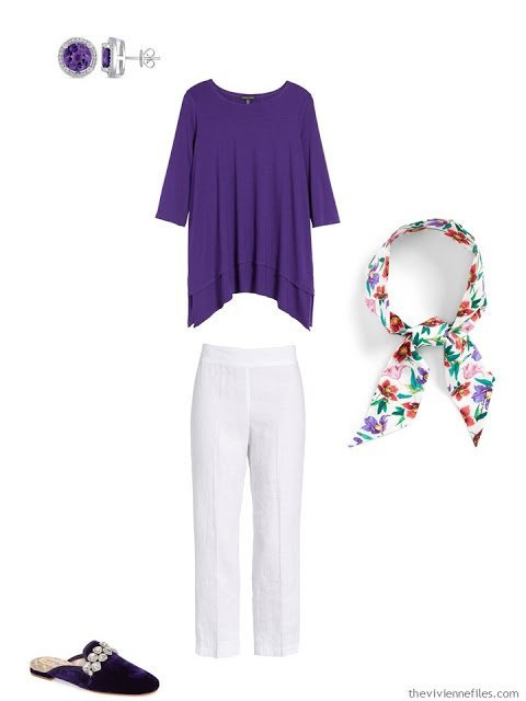 wearing an ultraviolet tunic with white linen pants