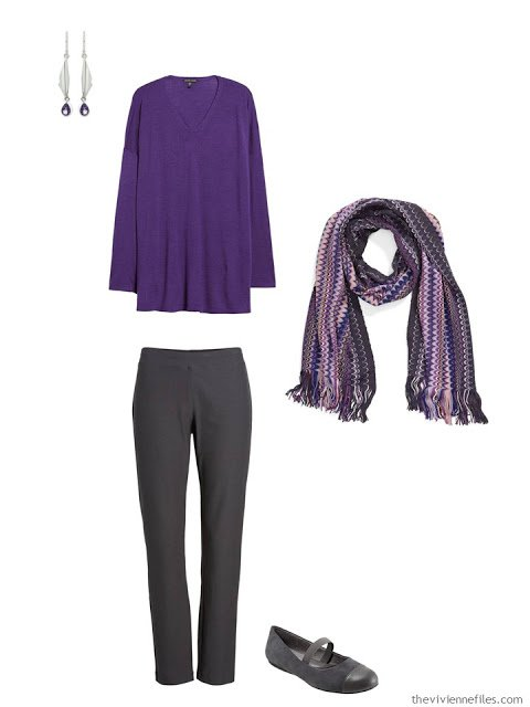 wearing an ultraviolet tunic with dark grey pants
