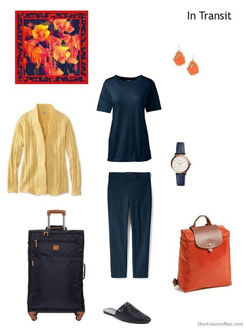 travel outfit in navy and yellow with orange accents