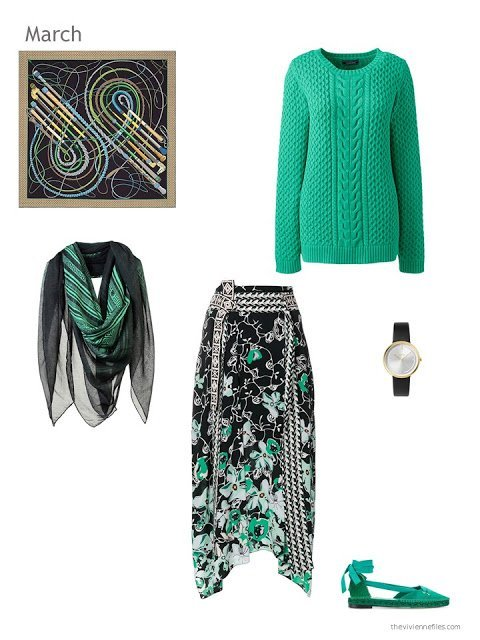green sweater with a green, black and white skirt