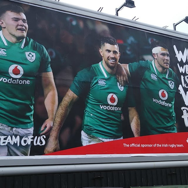 Vodafone billboard with Jacob Stockdale, Rob Kearney, and Peter O'Mahoney