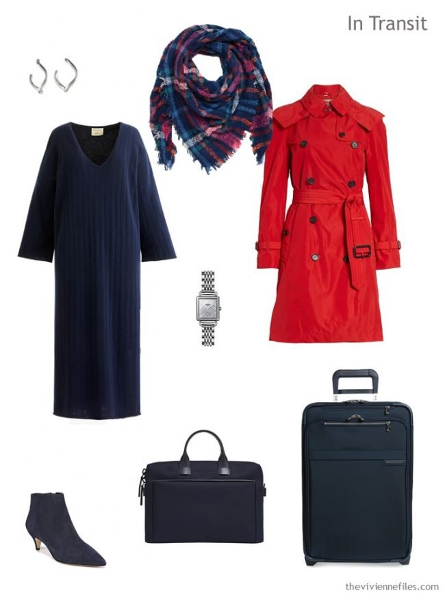 3. travel outfit of navy dress and red trench coat