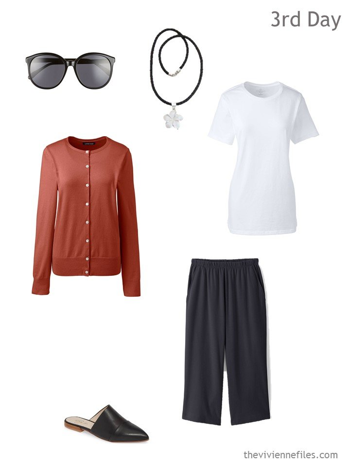 3. warm weather travel outfit in black, white and russet