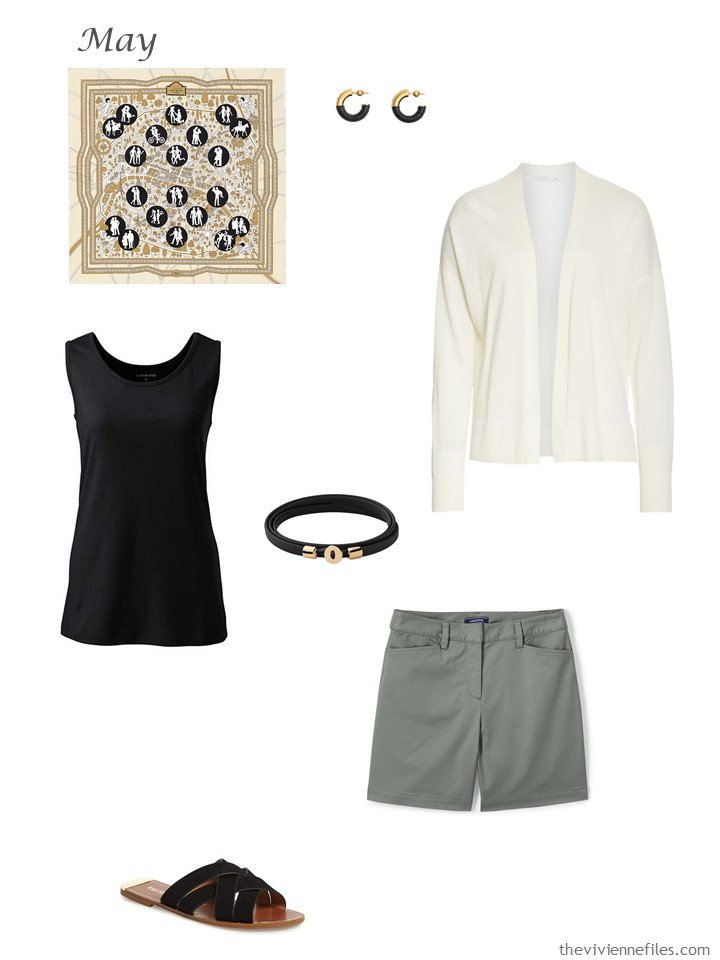 32. ivory cardigan, black tank top and green shorts