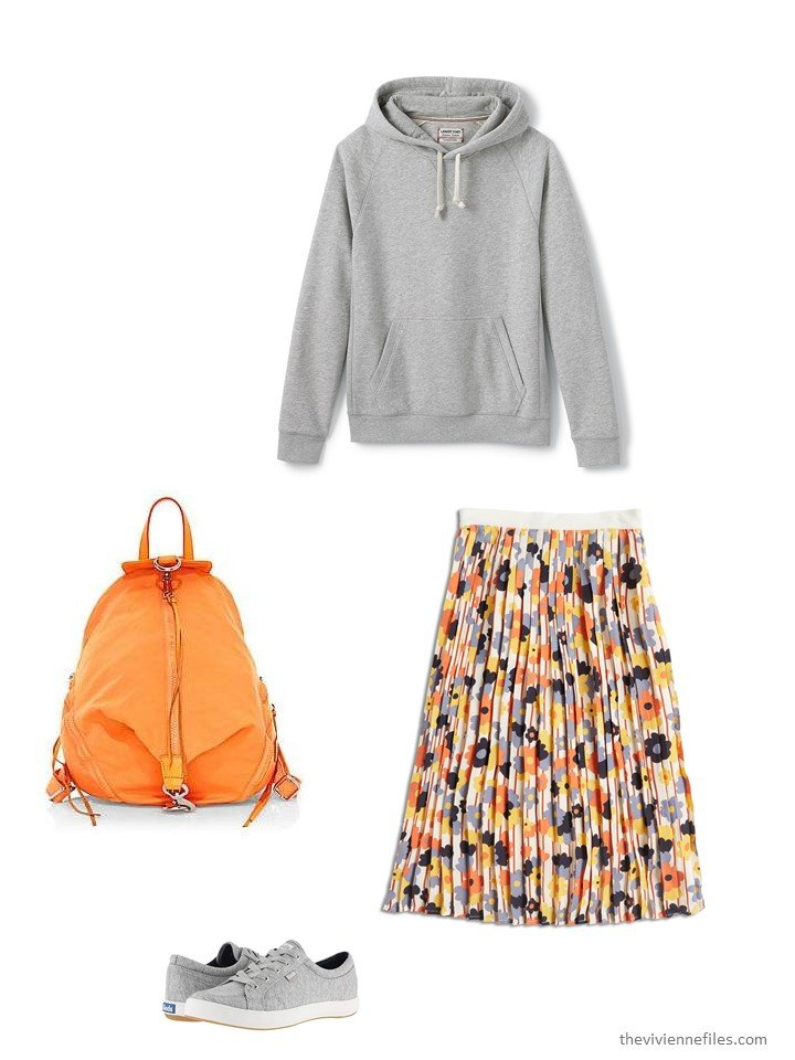 10. wearing a floral skirt with a sweatshirt
