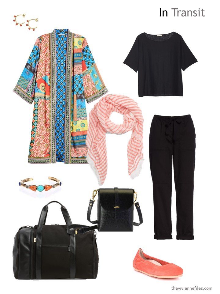 3. travel outfit in black with bright jacket
