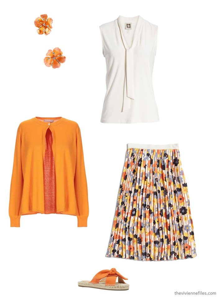 5. wearing a floral skirt with a sleeveless blouse and cardigan