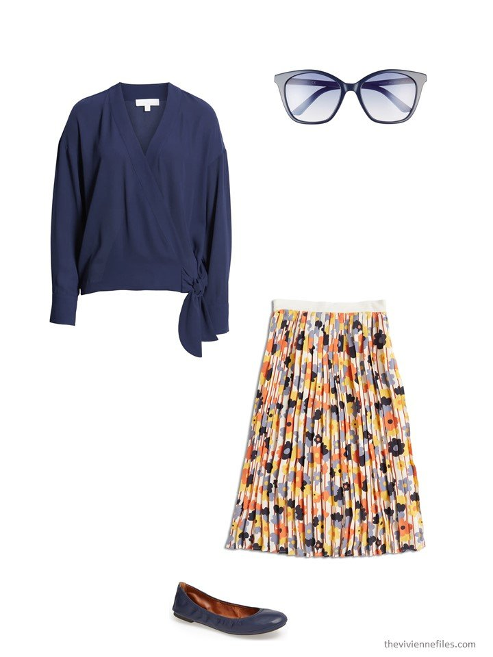 6.wearing a floral skirt with a navy blouse